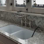 herringbone mosaic backsplash