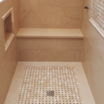 custom shower with mosaic insert, niches, and frame