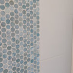 penny round tile shower accent