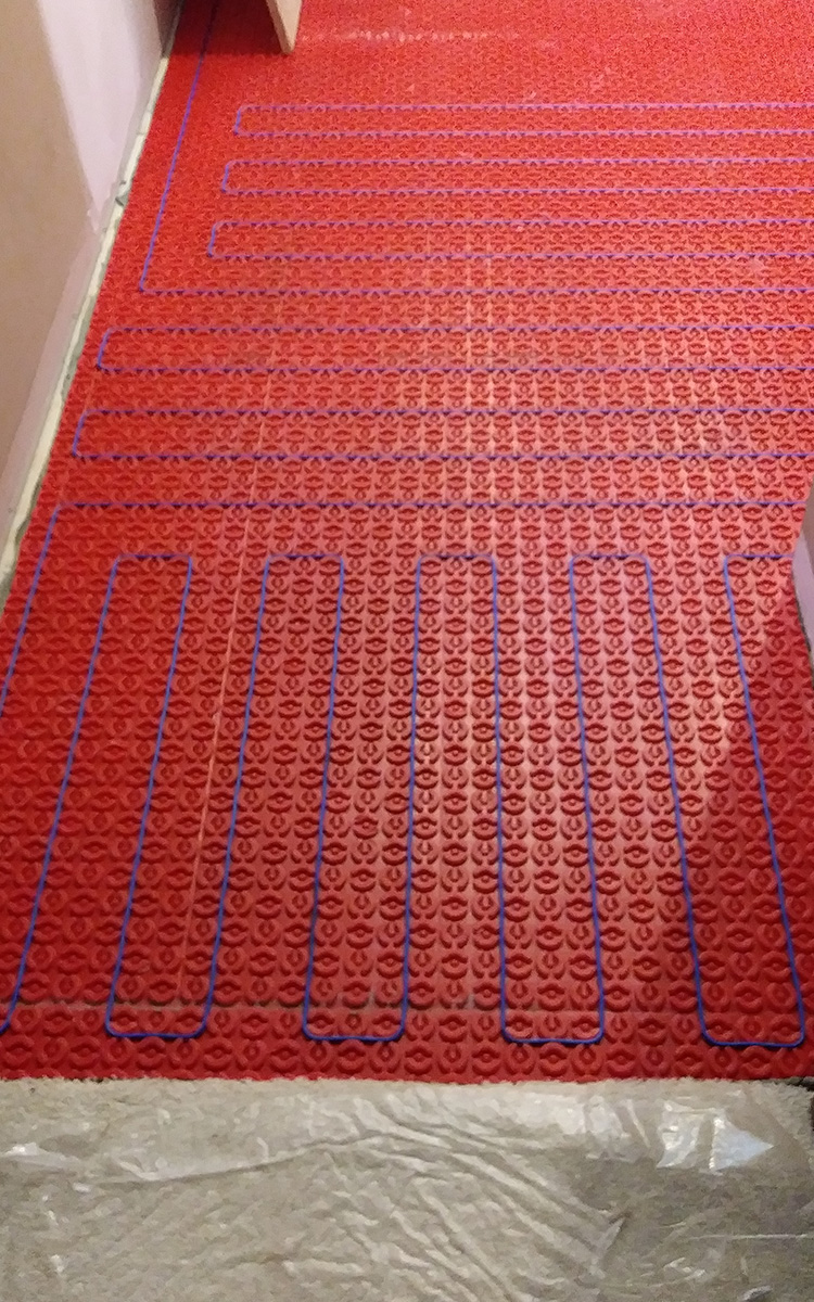 Heated floor cables in mat