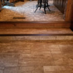 12x24 tile with Schluter nosing--step down into rustic den