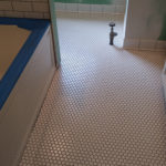 classic hexagon mosaic floor with tile baseboard