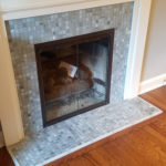 glass tile mosaic squares around a fireplace