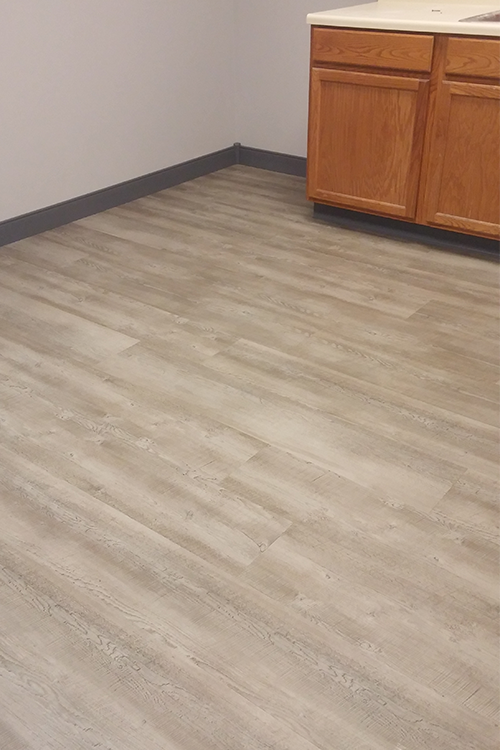 Timco Kitchen After with new Luxury Vinyl Plank Floors