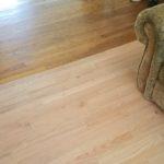 We removed numerous layers of sheet flooring and replaced it with new hardwood, which the customer then had stained to match the existing floor.