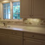 small backsplash adds color to kitchen